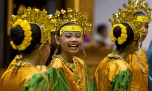 Girls wearing traditional costumes wait to greet foreign ministers before a cultural event attended by US Secretary of State John Kerry during the ASEAN security conference in Bandar Seri Begawan in Brunei.