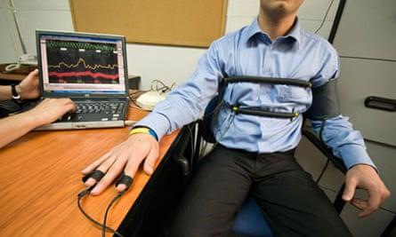 A man takes a lie detector test