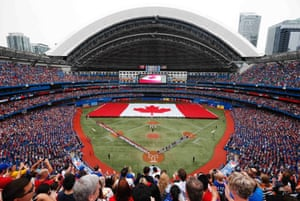 A giant Canadian flag is seen during the national anthem to commemorate Canada Day before the Toronto Blue Jays play Detroit Tigers in heir MLB American League baseball game in Toronto.