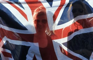 Tennis fans hold up a union flag in front of the big screen at the hill known as Murray Mound as Britain's Andy Murray beats Russia's Mikhail Youzhny in their fourth round men's singles match on day seven of Wimbledon. Photograph: Ben Stansall/AFP/Getty Images