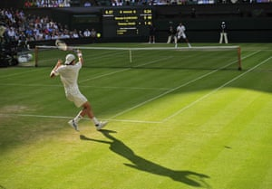 Germany's Tommy Haas (left) returns against Serbia's Novak Djokovic during their fourth round men's singles match on day seven of Wimbledon. Photograph: Glyn Kirk/AFP/Getty Images