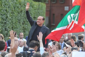 Former Italian premier Silvio Berlusconi greets members of a support rally outside his villa in Arcore. Berlusconi did not make a statement on the advice of his lawyers. Judges in Milan sentenced Berlusconi to seven years in prison and banned him for life from holding public office, rulings he will appeal. Photograph: Fabrizio Radaelli/EPA