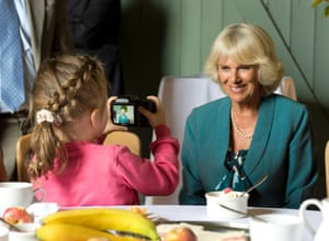 The Duchess of Cornwall with Neve Ritchie, 7, from Cardiff at a tea party in n Llwynywermod for children and their families from Dreams and Wishes, a charity that supports seriously ill young people. Photograph: Arthur Edwards/The Sun/PA