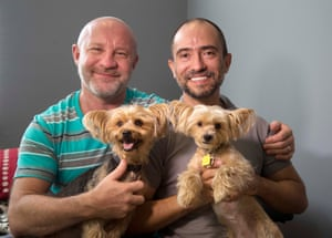 Family portrait: Julian Marsh, left, poses with his husband Tray Popov, a Bulgarian graduate student, and their Yorkshire terriers at their home in Fort Lauderdale, Florida. They are the first gay couple in the nation to have their application for immigration benefits approved after the supreme court ruling on same-sex marriages. Photograph: Wilfredo Lee/AP
