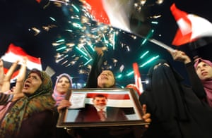 Supporters of Egypt's president Mohamed Morsi attend a rally in Nasser City, in Cairo. Photograph: Amr Nabil/AP