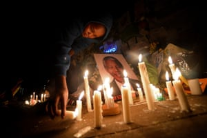 Children light candles by a Nelson Manela's portrait outside the MediClinic Heart hospital in Pretoria, South Africa. Mandela, who turns 95 next month, was rushed to hospital more than three weeks ago with a recurrent lung disease.
