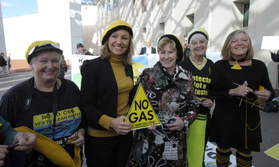 Australian Greens Senators Larissa Waters and Christine Milne pose with yellow beanies before speaking to landowners and protesters of the 'Lock the Gate' movement.