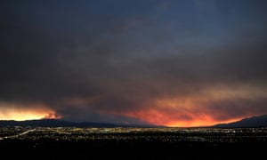 Smoke rises from the Carpenter 1 wildfire as the sun sets over Las Vegas.