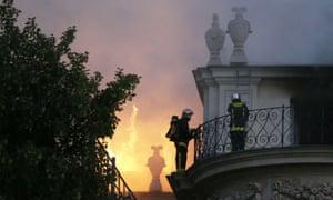 Firemen fight a blaze at the 17 century Hotel Lambert in Paris.