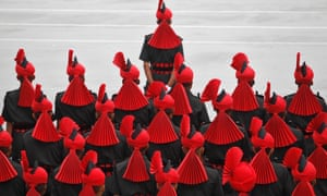 Indian army recruits stand to attention as they take part in a passing out parade at a garrison in Rangreth.