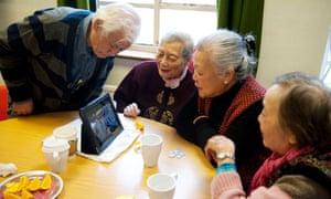 people look at an iPad