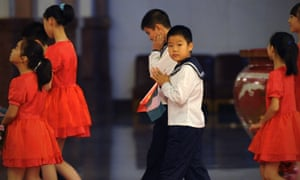Chinese children leave a welcoming ceremony for Nigerian President Goodluck Jonathan at the Great Hall of the People in Beijing.