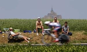 A cyclist rides past spectators during the Tour de France between Avranches and Mont-Saint-Michel.