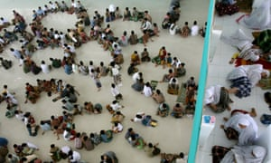 Students sit in circles during a Qu'ran recital class on the first day of Ramadan, at a boarding school in Medan, Indonesia.
