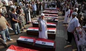 Supporters of ousted president Mohamed Morsi gather around coffins, a day after fellow protesters were killed in clashes, inside Rabaa al-Adawiya mosque in Cairo.
