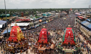 Devotees crowd around the chariot of Lord Jagannath and his sister Subhadra during the annual Rath Yatra or chariot procession in Puri, India. The three idols of Hindu God Jagannath, his brother Balabhadra and sister Subhadra are taken out in a grand procession in specially made chariots called raths. Photograph: Biswaranjan Rout/AP
