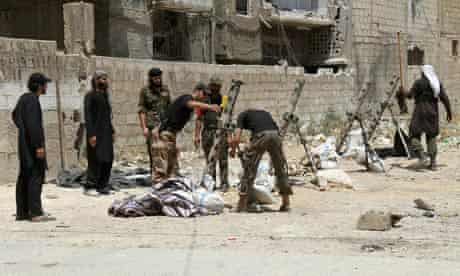 Syrian rebel fighters prepare their weapons in the capital Damascus