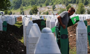 Workers doing final preparations at the Potocari Memorial Centre in Srebrenica. 409 newly-identified Bosnian Muslims will be buried on 11 July 2013 as part of a memorial ceremony to mark the 18th anniversary of the Srebrenica massacre.