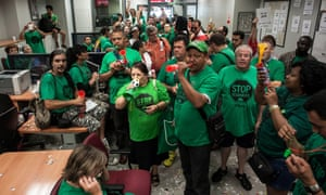Activists from the association for Mortgage Victims (PAH) occupy the Banco Popular bank in Barcelona.