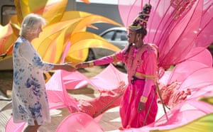 Camilla, Duchess of Cornwall meets a carnival performer while visiting the Hampton Court Palace Flower Show in London.