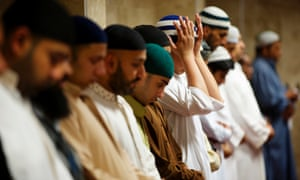 Muslim men attending the Jamia Ghosia Mosque in Blackburn marking the start of Ramadan. See more from Christopher Thomond in Lancashire in the audioslideshow.