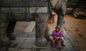 A woman begs for alms outside a temple at the ancient city of Bhaktapur, Nepal.
