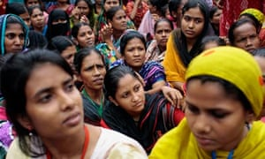 Bangladeshi women protest over pay and working conditions outside a garment factory in Dhaka.