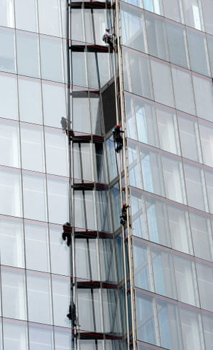 Six female activists of Greenpeace climb The Shard protesting against drilling for oil in the Arctic for theSave the Arctic campaign. Photograph: Andy Rain/EPA