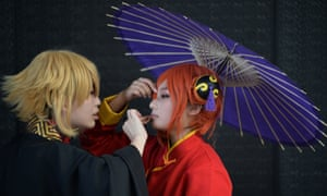 Cosplay fans get ready on the opening day of the 9th China International Comics Games Expo in Shanghai.