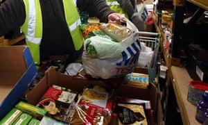 Workers at a food bank preparing parcels