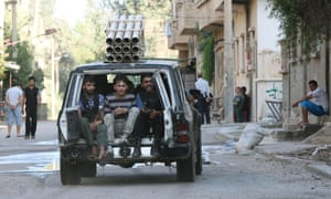 Free Syrian Army fighters travel in a car mounted with a rocket launcher in Deir al-Zor. Read the latest report from eastern Syria.