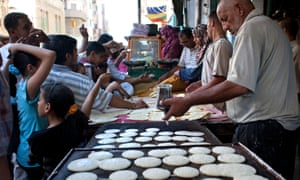 """People line up for sweets called """"qatayef"""" specially prepared for Ramadan, in Damanhour, Egypt. See more from Holly Pickett around Egypt in the gallery here."""