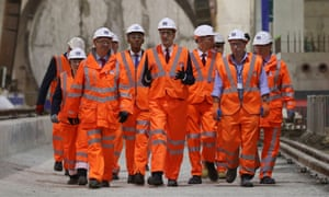 Labour leader Ed Miliband, centre, arrives for a visit to the Crossrail site at Canary Wharf in London, ahead of the party's growth review.