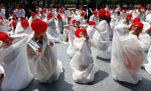 Demonstrators dressed up as embryos gather outside the French parliament in Paris to protest a draft law aimed at authorising scientific research on embryonic stem cells.
