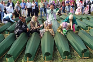 Bosnian women cry near the coffins of their relatives at the Potocari Memorial Centre in Srebrenica during the burial of 409 newly-identified Bosnian Muslims. The bodies of the recently identified victims are being buried today marking the 18th anniversary of the massacre in which Bosnian Serb forces commanded by Ratko Mladic killed up to 8,000 Muslim men and boys. The massacre is considered the worst atrocity of Bosnia's 1992-95 war.