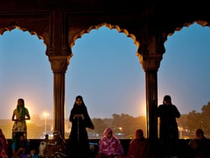 Muslim women offer prayers after breaking their fast on the first day of Ramadan at the Jama Masjid Mosque in New Delhi, India.
