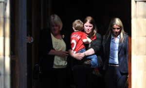 The family, including wife Rebecca carrying son Jack, leave Bury Parish church after the vigil.