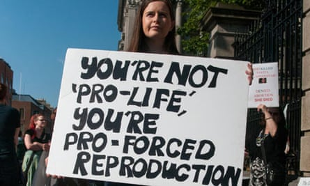 A pro-choice demonstrator stands outside the Irish parliament