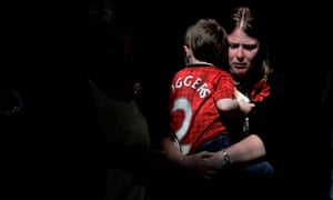 Wife Rebecca and son Jack leave Bury parish church after a vigil on the eve of Lee Rigby's funeral