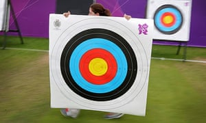 Woman walking with an archery target