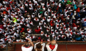 Runners wait for the start of the sixth running of the bulls of the San Fermin festival in Pamplona. Four runners were gored in a run that lasted four minutes and fifty seven seconds.