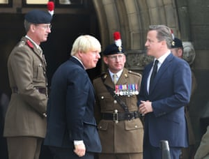 Boris Johnson and David Cameron arrive for the military funeral service.