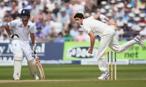 Mitchell Starc bowls watched by Alastair Cook.