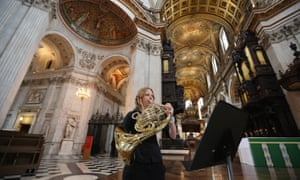 Musician Carly Lake plays her french horn during a performance of an eight-minute piece called Live Music Sculpture 3: St Paul's Cathedral. The work has been composed by Samuel Bordoli specifically for the cathedral's acoustic properties and features 27 musicians in six groupings spread throughout the vertical and horizontal points of the building