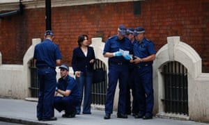 Police officers perform a security sweep outside St Mary's hospital in London. Media are already camped out preparing for royal-mania as the Duchess of Cambridge is to give birth at the Lindo Wing some time very soon
