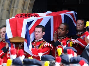 The coffin of murdered Drummer Lee Rigby is carried from Bury parish church in Greater Manchester following his funeral service