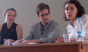 Edward Snowden along with Sarah Harrison of WikiLeaks (left) at a press conference in Sheremetyevo