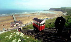 Some like it hot. The Saltburn Inclined Tramway delivers families to the cliff top during the hot weather at Saltburn-by-the-Sea, North Yorkshire. This weekend is set to bring the hottest day of the year so far, with weather experts predicting temperatures reaching a sizzling 31C tomorrow.
