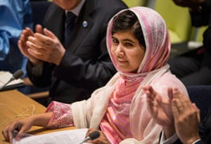 Malala Yousafzai, the 16-year-old Pakistani advocate for girls' education who was shot in the head by the Taliban, is applauded before she speaks at the United Nations Youth Assembly in New York City. The United Nations has declared 12 July – her birthday – Malala Day.