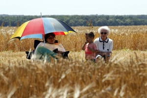 tour de france: Supporters wait for riders along the road